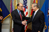 "United States Secretary of Defense Donald H. Rumsfeld (right) congratulates Federal Reserve Chairman Alan Greenspan (left) after awarding him the Department of Defense Medal for Distinguished Public Service at the Pentagon in Arlington, Virginia, on January 23, 2006.  Greenspan was cited for his contribution ""...to a strong national defense by helping promote the continued and steady growth of the economy of the United States"".  <br /> Credit: Chad J. McNeeley - DoD via CNP"