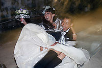 Yakutsk, Yakutia, Russia, 19/08/2011..Newly-weds Nadezhda and Vasily Fedorov on an ice slide inside the Permafrost Kingdom, an underground tourist attraction inspired by the extreme cold of Yakutia. The 150 metre deep complex of tunnels in the Russian permafrost are decorated with ice sculptures, a wolf-fur covered throne, an office complete with the coolest computer and telephone, a children's slide and other ingenious creations - all hewn from blocks of ice.