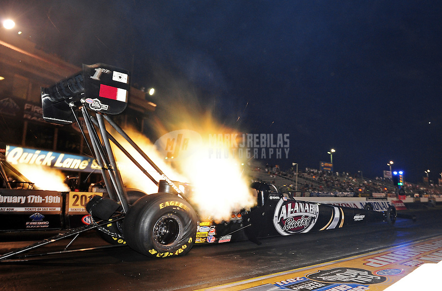 Oct. 14, 2011; Chandler, AZ, USA; NHRA top fuel dragster driver Larry Dixon during qualifying for the Arizona Nationals at Firebird International Raceway. Mandatory Credit: Mark J. Rebilas-