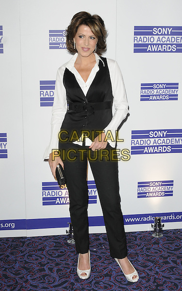 NATASHA KAPLINSKY.The Sony Radio Academy Awards 2011, Grosvenor House Hotel, Park Lane, London, England..May 9th, 2011.full length black trousers waistcoat white shirt clutch bag peep toe shoes .CAP/CAN.©Can Nguyen/Capital Pictures.