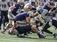 Annapolis, MD - October 21, 2017: Navy Midshipmen quarterback Zach Abey (9) gets tackled by several UCF Knights defenders during the game between UCF and Navy at  Navy-Marine Corps Memorial Stadium in Annapolis, MD.   (Photo by Elliott Brown/Media Images International)