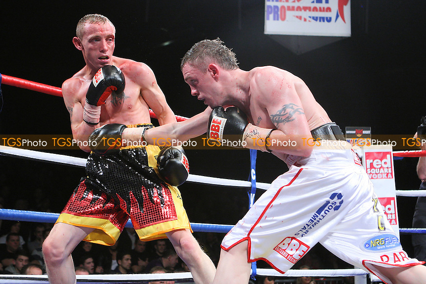 Jason Booth (white shorts) defeats Jamie Arthur in a Super-Middleweight contest for the British and Commonwealth Titles at the Brentwood Centre, promoted by Frank Maloney - 05/02/11 - MANDATORY CREDIT: Gavin Ellis/TGSPHOTO - Self billing applies where appropriate - Tel: 0845 094 6026