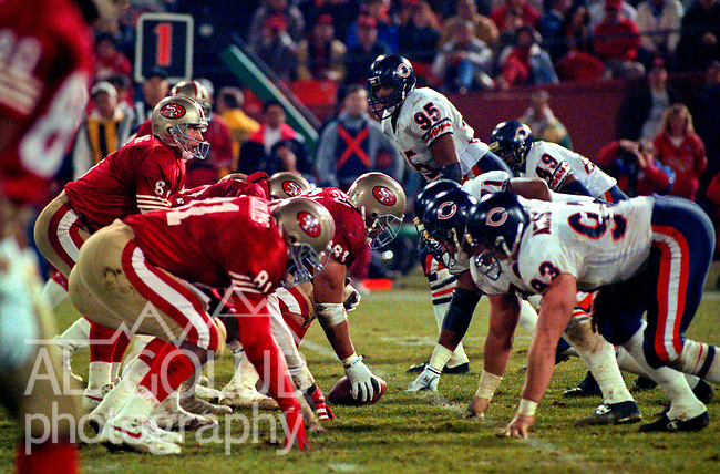 San Francisco 49ers vs. Chicago Bears at Candlestick Park Monday, December 23, 1991.  49ers beat Bears 52-14.  49er quarterback Steve Young (8) and offensive line up against Bear defensive line.
