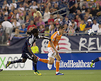 Houston Dynamo midfielder Geoff Cameron (20) on the attack as New England Revolution midfielder Shalrie Joseph (21) closes. In a Major League Soccer (MLS) match, the New England Revolution tied Houston Dynamo, 1-1, at Gillette Stadium on August 17, 2011.