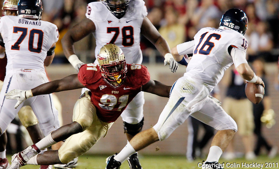TALLAHASSEE, FL 11/19/11-FSU-UVA111911 CH-Florida State's Cornellius Carradine sacks Virginia's Michael Rocco  during first half action Saturday at Doak Campbell Stadium in Tallahassee. .COLIN HACKLEY PHOTO