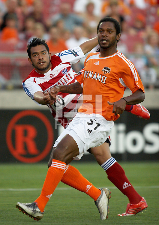 Houston Dynamo's Ardian Serioux (51) attempts to stop a shot of FC Dallas' Carlos Ruiz (20) at Robertson Stadium in Houston, TX on Saturday May 6, 2006. The Houston Dynamo defeated FC Dallas 4-3.