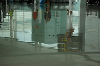 Reflections of passengers on highly polished tiles in terminal departure at Barcelona airport, Spain.