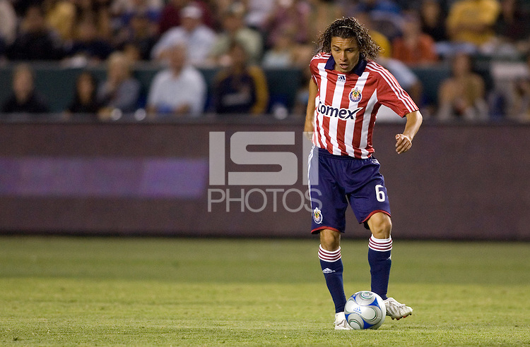 Chivas USA midfielder Francisco Mendoza (6) looks for a teammate during a MLS game. Chivas USA and the LA Galaxy played to a 1-1 draw at Home Depot Center stadium, in Carson, California on Thursday, July 10, 2008.