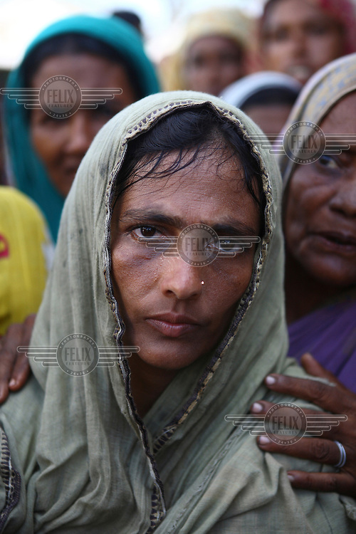 A portrait of a displaced woman. Thousands of people were displaced in Shyamnagar Upazila, Satkhira district after Cyclone Aila struck Bangladesh on 25/05/2009, triggering tidal surges and floods....