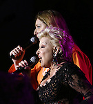 "Judy Gold and Bette Midler performing Bette Midler's New York Restoration Project's Annual ""Hulaween in the Big Easy"" at  the Waldorf Astoria on October 31, 2013  in New York City."