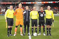 MLS referees with Sporting Kansas City captain Jimmy Nielsen and D.C. United captain Dwayne De Rosario at the coin toss.  Sporting Kansas City defeated D.C. United  1-0 at RFK Stadium, Saturday March 10, 2012.