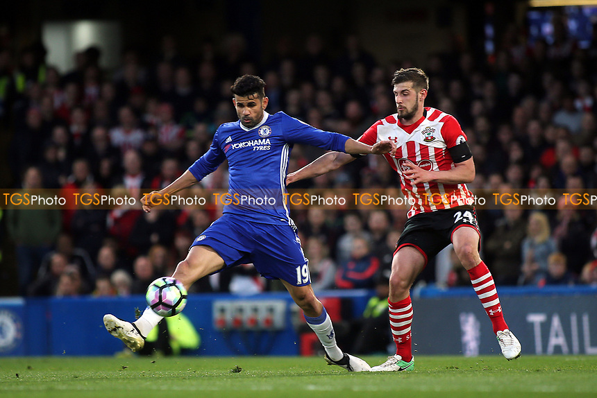 Diego Costa of Chelsea shields the ball from Southampton's Jack Stephens during Chelsea vs Southampton, Premier League Football at Stamford Bridge on 25th April 2017