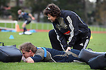 All Blacks Dr Deborah Robinson tends to first-five Nick Evans.