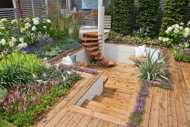 Sunken deck landscaping and garden plant flower stock for Beautiful garden decking