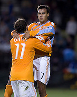 Chris Wondolowski (7) celebrates his goal with Brad Davis (11). San Jose Earthquakes defeated Houston Dynamo 3-2 at Buck Shaw Stadium in Santa Clara, California on March 28th, 2009.