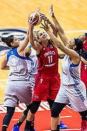 Washington, DC - Sept 17, 2017: Washington Mystics guard Elena Delle Donne (11) goes up strong to the basket against Minnesota Lynx forward Cecilia Zandalasini (9) and Minnesota Lynx guard Renee Montgomery (21) during playoff game between the Mystics and Lynx at the Verizon Center in Washington, DC. (Photo by Phil Peters/Media Images International)