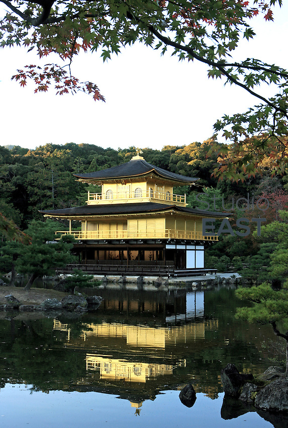 Kinkaku-ji, the Golden Pavilion Temple, stands above its reflection in Kyoto, Japan, on November 9, 2006. Kinkaku-ji or 'Golden Pavilion Temple' was originally built in 1397 to serve as a retirement villa for Shogun Ashikaga Yoshimitsu, but was turned by his son, shogun Ashikaga Yoshimochi, into a Zen temple. Kyoto is the former imperial capital of Japan, and today houses more than 1.5 million. Photo by Lucas Schifres/Pictobank
