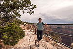 A hiker pauses to pose for a portrait along the Rim Trail of the Grand Canyon, Arizona, USA, in September.