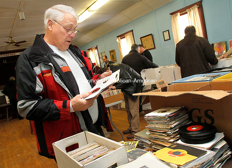 WOLCOTT, CT.- 01 MARCH 2014 - 030214JW04 - John Kelly of Naugatuck looks through vinyl recordsSaturday morning during the Wolcott Grange's first records and music show.<br /> Jonathan Wilcox Republican-American