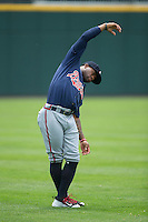 Eric Young Jr. (14) of the Gwinnett Braves stretches in the outfield prior to the game against the Charlotte Knights at BB&T BallPark on July 3, 2015 in Charlotte, North Carolina.  The Braves defeated the Knights 11-4 in game one of a day-night double header.  (Brian Westerholt/Four Seam Images)