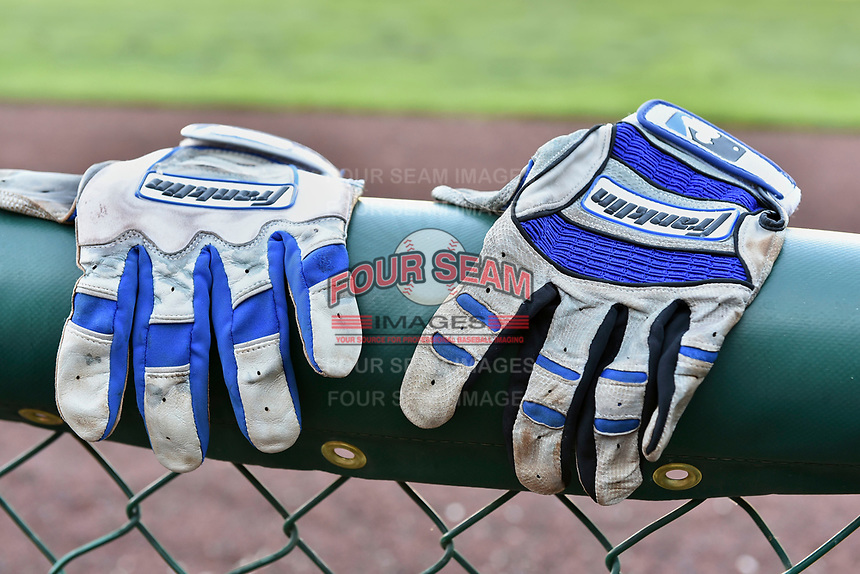 Batting gloves sit on the rail prior to the game between the Orem Owlz and the Ogden Raptors in Pioneer League  action at Lindquist Field on June 22, 2017 in Ogden, Utah. The Owlz defeated the Raptors 13-8.  (Stephen Smith/Four Seam Images)