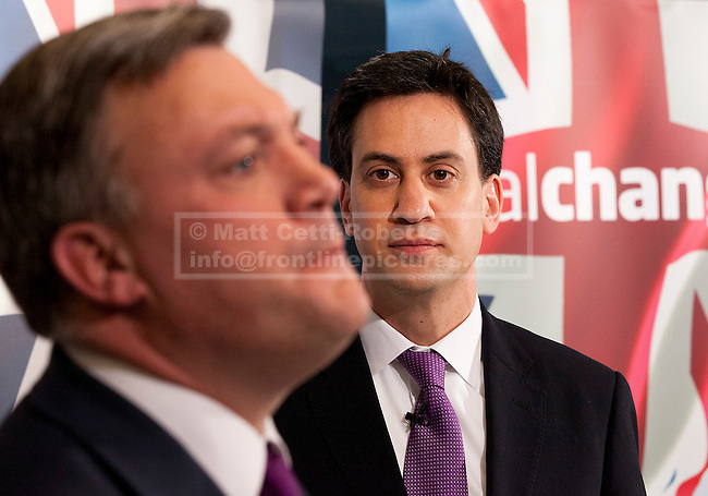 08/07/2012. LONDON, UK. Labour Leader, Ed Miliband (R), watches on as the shadow chancellor, Ed Balls, answers questions after a talk by on responsible banking at the Cooperative Bank in East London today (09/07/12). Photo credit: Matt Cetti-Roberts