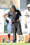 Manhattan Beach, CA 10/27/11 - Coach James Mays in action during the Peninsula vs Mira Costa Junior Varsity football game.