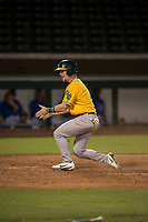 AZL Athletics designated hitter Nick Ward (4) celebrates after scoring a run during an Arizona League game against the AZL Cubs 1 at Sloan Park on June 28, 2018 in Mesa, Arizona. The AZL Athletics defeated the AZL Cubs 1 5-4. (Zachary Lucy/Four Seam Images)