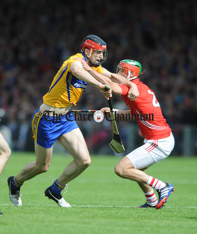 Stephan Mc Donnell of Cork in action against Darach Honan of Clare during their Munster senior championship semi-final in The Gaelic Grounds. Photograph by John Kelly.