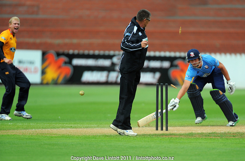 Wellington's Harry Boam runs out Colin De Grandhomme with a direct hit. One Day cricket - Wellington Firebirds v Auckland Aces at Allied Nationwide Finance Basin Reserve, Wellington on Wednesday, 2 February 2011. Photo: Dave Lintott / lintottphoto.co.nz