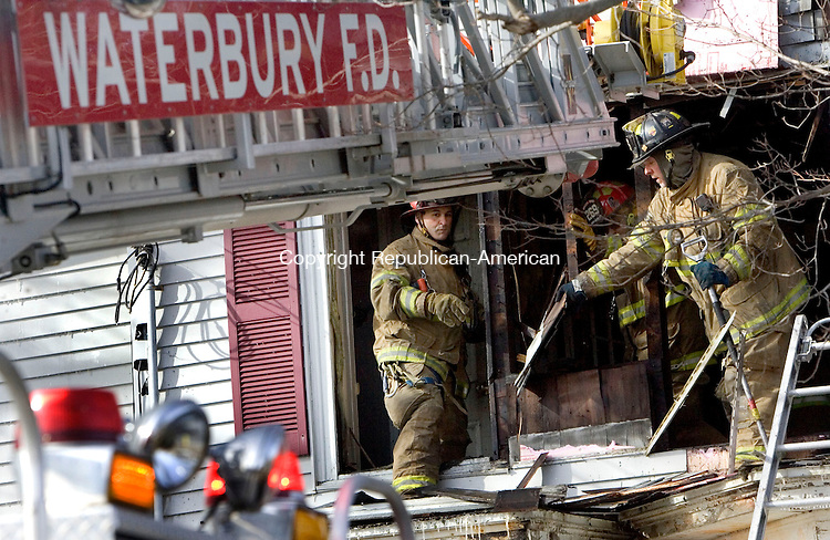 WATERBURY CT. 04 March 2014-030414SV06-Firefighters extinguish an early morning fire that destroyed a home at 462 Highland Avenue in Waterbury Tuesday. The cause is under investigation. <br /> Steven Valenti Republican-American