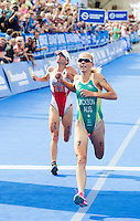 12 JUL 2014 - HAMBURG, GER - Kirsten Sweetland (CAN) (left) from Canada loses the sprint to the finish line for second place to Emma Jackson (AUS) (right) from Australia at the elite women's 2014 ITU World Triathlon Series round in the Altstadt Quarter in Hamburg, Germany (PHOTO COPYRIGHT © 2014 NIGEL FARROW, ALL RIGHTS RESERVED)