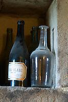 old bottle vin blanc in a niche chateau curson dom pochon crozes hermitage rhone france