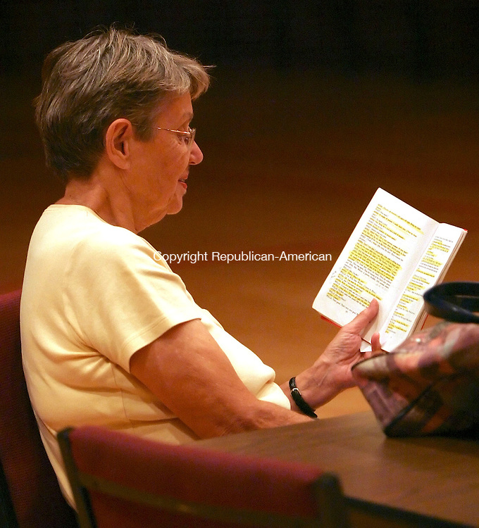 SOUTHBURY,  CT 31 August 2005 -083105BZ09- Pat Maurer, who is doing sound for the show, reads a script<br /> during rehearsal for &quot;A Bad Year For Tomatoes&quot; at Heritage Village Wednesday night.<br />  Jamison C. Bazinet / Republican-American
