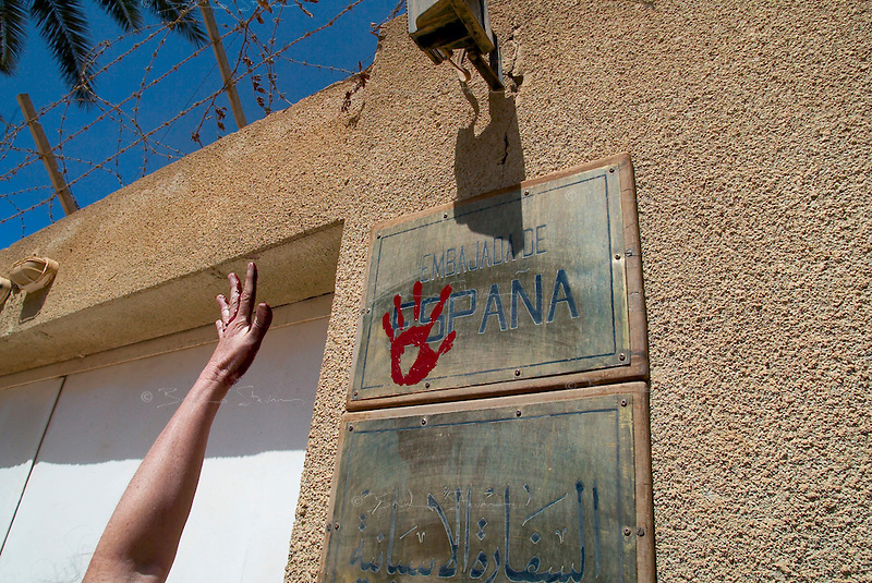 "Baghdad, Iraq, March 28, 2003.A Spanish ""Brigadist for Peace"" stamps hands imprintswith red paint on the door of the Spanish embassy in Baghdad to protest against the Spanish involvement in the war against Iraq."