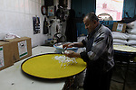 A Palestinian baker, prepares a Nabulsi Kunafa, a traditional and favorite local sweet at his shop, in the West Bank city of Nablus December 23, 2014. Photo by Nedal Eshtayah