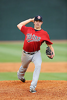 Pitcher Sam Gibbons (35) of the Elizabethton Twins delivers a pitch in a game against the Johnson City Cardinals on Sunday, July 27, 2014, at Howard Johnson Field at Cardinal Park in Johnson City, Tennessee. The game was suspended due to weather in the fifth inning. (Tom Priddy/Four Seam Images)