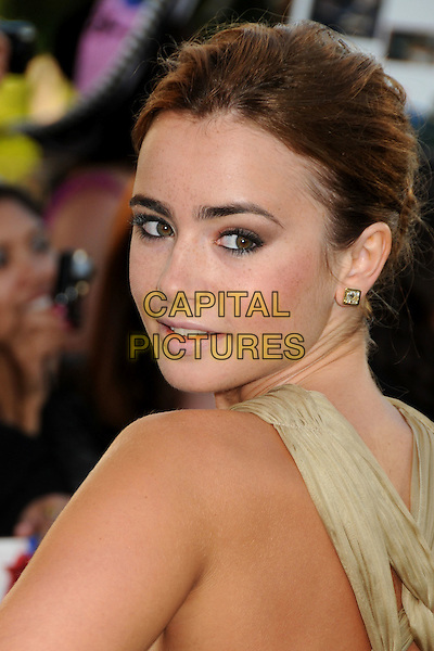 "LILY COLLINS .""The Twilight Saga: Eclipse"" Los Angeles Premiere at the 2010 Los Angeles Film Festival held at Nokia Theatre LA Live, Los Angeles, California, USA, 24th June 2010..portrait headshot gold beige dress hair up make-up studs earrings profile looking over shoulder back rear behind .CAP/ADM/BP.©Byron Purvis/AdMedia/Capital Pictures."