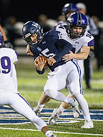 NWA Democrat-Gazette/BEN GOFF @NWABENGOFF<br /> Blaise Wittschen, Springdale Har-Ber quarterback, breaks the tackle of Friday, Nov. 2, 2018, during the game at Wildcat Stadium in Springdale.