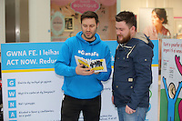 Pictured L-R: Ian Robson with Adam Griffiths Saturday 18 Saturday<br />Re: Welsh Government Dementia Risk Prevention Roadshow at the Quadrant Shopping Centre in Swansea, Wales, UK.
