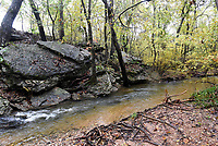 NWA Democrat-Gazette/FLIP PUTTHOFF <br /> Sunshine Creek, also called Avalon Creek, seen Oct. 29 2019 along the Tanyard Creek Nature Trail, flows past boulders and bluffs near the Tanyard Creek waterfall.