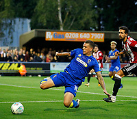 AFC Wimbledon's Cody McDonald dives to keep the ball in  during the Carabao Cup match between AFC Wimbledon and Brentford at the Cherry Red Records Stadium, Kingston, England on 8 August 2017. Photo by Carlton Myrie.