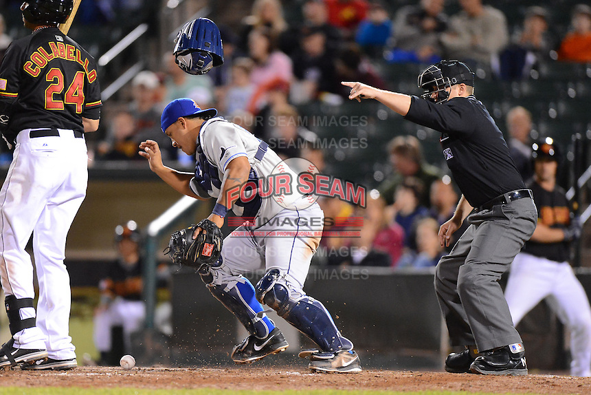 Durham Bulls catcher Juan Apodaca #13 fields a blocked ball as umpire Jeff Gosney signals the batter went during a game against the Rochester Red Wings on May 17, 2013 at Frontier Field in Rochester, New York.  Rochester defeated Durham 11-6.  (Mike Janes/Four Seam Images)
