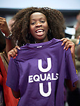 """A woman displays a shirt during a July 25 activity in the Global Village of the 2018 International AIDS Conference in Amsterdam, Netherlands. She is holding a """"U Equals U"""" shirt, which celebrates new research that shows that HIV positive people with undetectable viral loads cannot transmit the disease through sex."""