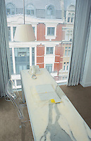 Desk and bedroom at the St Martins Lane Hotel in London designed by philippe stark. 08-02