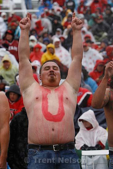 "shirtless Utah fans with ""Go Utes!"" painted on their bellies. Salt Lake City - Utah vs. Utah State college football Saturday afternoon at Rice-Eccles Stadium..; 9.29.2007"
