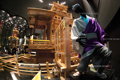 "February 14, 2013, Kawagoe, Japan - A doll wearing traditional Japanese clothes and dashi (portable shrine) structure at the Kawagoe Festival Museum. An old town from Edo Period (1603-1867) is located in Kawagoe, 30 minutes by train from central Tokyo. In the past Kawagoe was an important city for trade and strategic purpose, the shogun installed some of their most important loyal men as lords of Kawagoe Castle. Every year ""Kawagoe Festival"" is held in the third weekend of October, people pull portable shrine during the parade, later ""dashi"" floats on the streets nearby. The festival started 360 years ago supported by Nobutsuna Matsudaira, lord of Kawagoe Castle. (Photo by Rodrigo Reyes Marin/AFLO).."