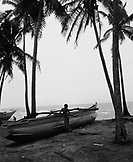 SRI LANKA, Asia, fisherman standing by boat at Galle