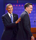 United States President Barack Obama, the Democratic Party nominee for President, has a pat on the back for former Massachusetts Governor Mitt Romney, the Republican Party nominee for President, following their face-off in the first Presidential Debate of the 2012 General Election at the University of Denver in Denver, Colorado on Tuesday, October 2, 2012..Credit: Ron Sachs / CNP.(RESTRICTION: NO New York or New Jersey Newspapers or newspapers within a 75 mile radius of New York City)