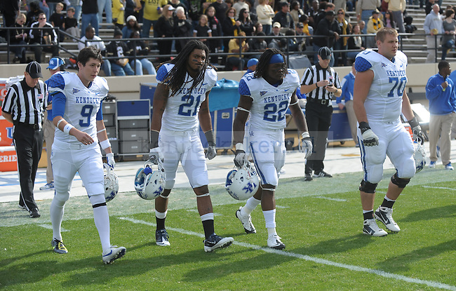 UK's game captains walk onto the field before the University of Kentucky Football game against  Vanderbilt at Vanderbilt Stadium in Nashville, Tn., on 11/12/11. Uk lost the game 8-38. Photo by Mike Weaver | Staff